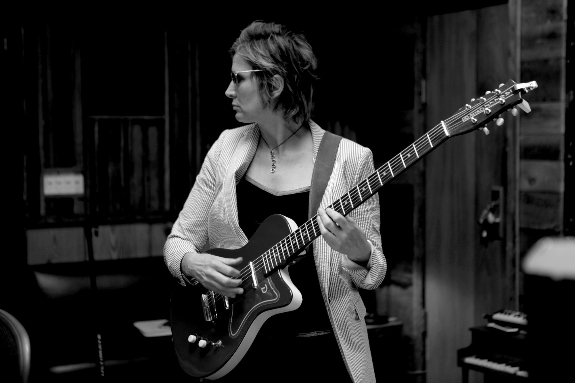 Singer Annie Keating playing guitar