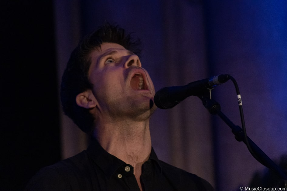 Seth Lakeman singing while looking up at Southwark Cathedral's ceiling